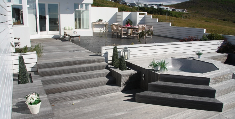 Weathered decking, white fences and a veiw